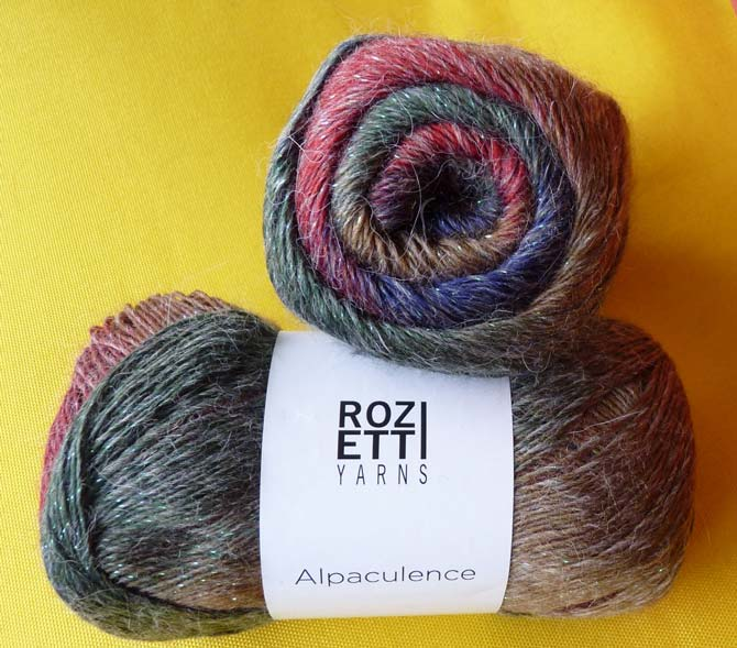 Rozetti Alpaculence is a soft acrylic, wool, alpaca, and glitter yarn with long stretches of color at a time.