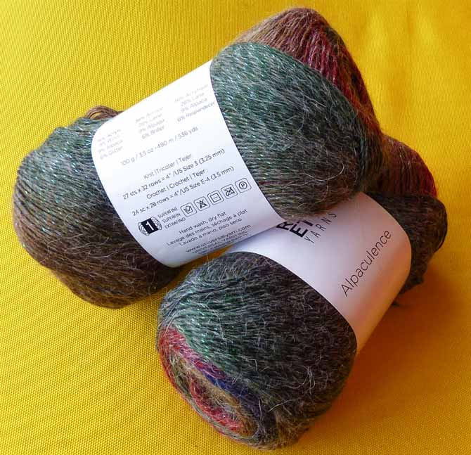 "The agate colorway of Alpaculence yarn, showing the ""stats"" side of the ball band."