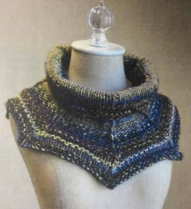 "A rather pretty cowl in shades of navy and denim, with a wide ""turtle"" neck that flares out over the shoulders into 6 points"