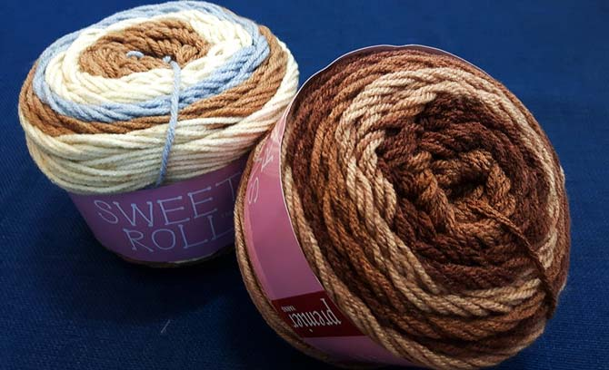 These 2 rolls called Capuccino Pop (top left) and Caramel Swirl (right) make me thirsty to knit!