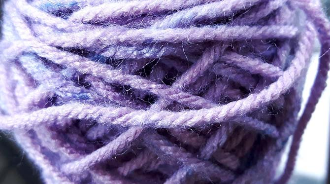 This blend of cornflower blue and lavender fibers make up a heather color section in the Punch Pop colorway.
