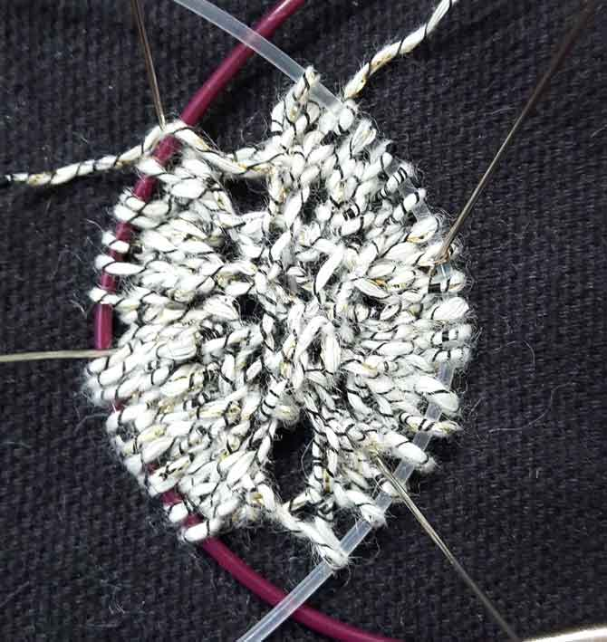 Close up of the garter stitch tab center