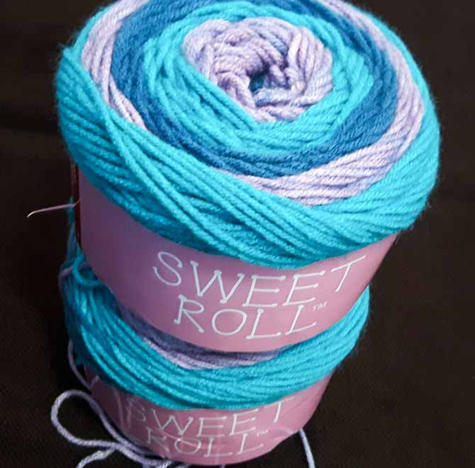 Sweet Roll yarn stacks up to your most imaginative ideas. The Punch Pop colorway features lavender, bright turquoise, and a rich teal.