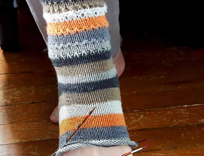 3 of the colors in the stripe sequence are missing because of the heel. There is a solution to this though, winding off a small amount of the same colors that would appear in the heel and use them to knit the heel so that when you resume the rest of the stitches, you still have those colors of stripes on stand-by.