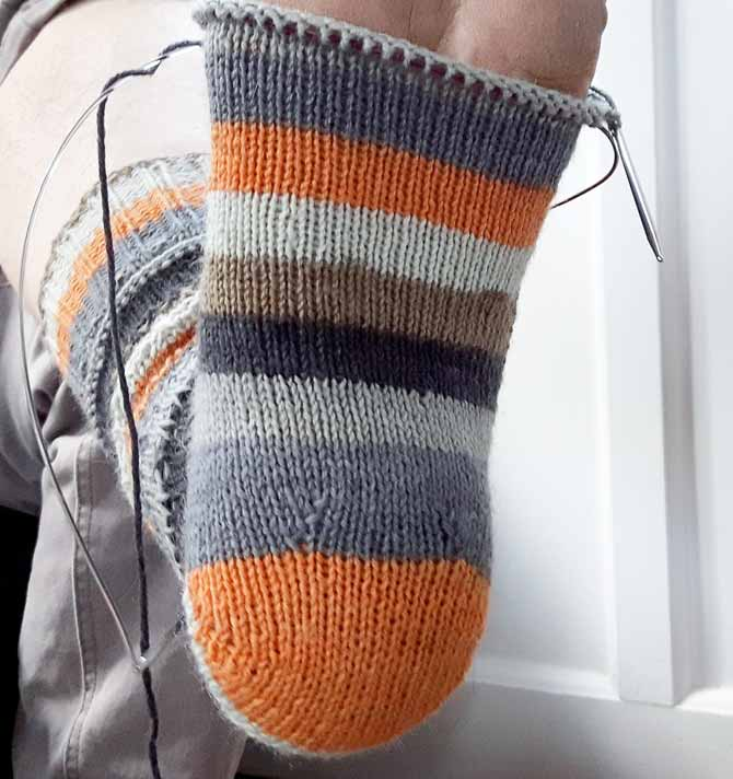 Here's a great tip for socks headed to a wearer with a high instep: hide a few increases under the heel to allow the sock to rise up over the instep. Four or (in this case) six stitches will give the wearer just the right amount of ease to slip that sock on and off without a struggle!