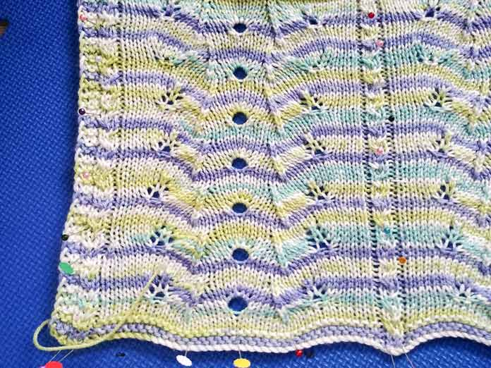 The W-stitch lovey blanket getting blocked so its motifs can really stand out!