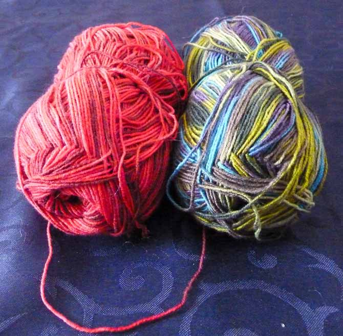 A partial ball each of Allegro sock weight, and Naked Sock.