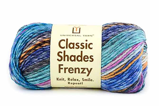 Skein of Classic Shades Frenzy in Harbor Lights colorway which features peacock and marine blues as well as teal and aqua with small amounts of melon orange, pink, charcoal and flecks of white.