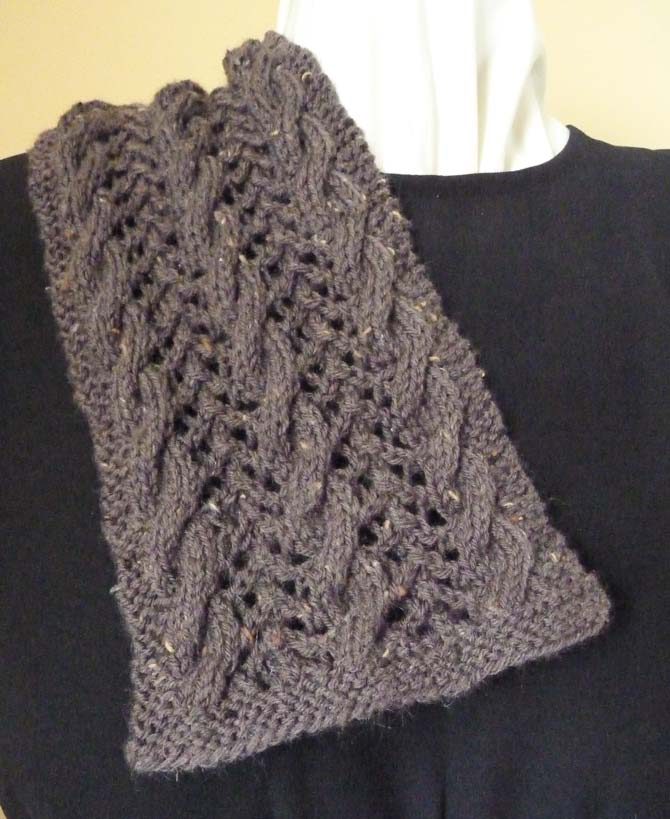 "The scarf, knit for about 12"" [30cm], draped over a dress form to show how the edges are straight, and not inclined to curl."