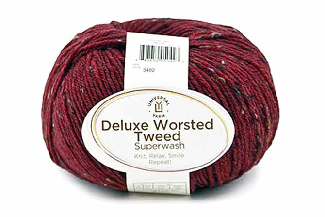 Ball of Deluxe Worsted Tweed Superwash in Garnet colorway which features a deep wine color with black, taupe and camel tweedy flecks