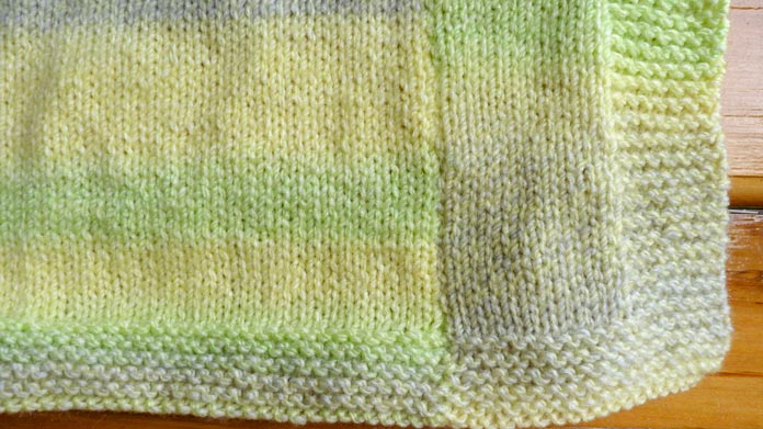 Fun with stripes! The right panel of this baby blanket has 20 stitches, and the center panel has 60 stitches.
