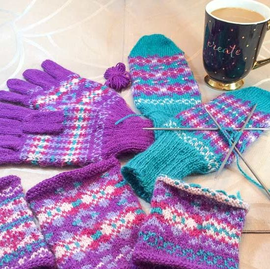 "All my knitted results for my week of knitting with Finn - remember, this photo shows the full ball of purple I used - the butterfly is the leftover! Now, I'll finish knitting the thumb while I drink that coffee from my ""Create"" mug. Create, indeed!"