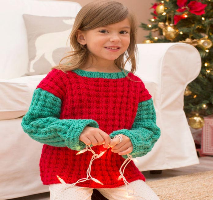 The Jolly Kids' Sweaters were originally designed in Christmas red and green, as you can clearly see!