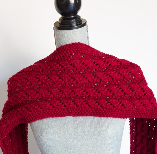 Knitting up this wrap is quick with Aran weight yarn.