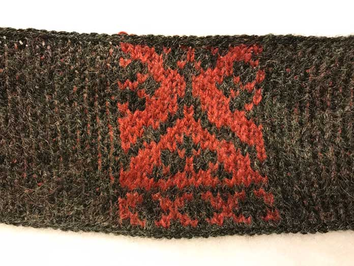 The pattern for the Templetop Cowl in the colors Oxblood and Ebony. The darker color contrasts are very eye catching.