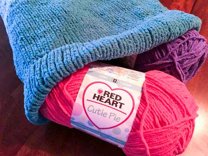 You can't beat the softness of Red Heart's Cutie Pie yarn to make this snuggle sack
