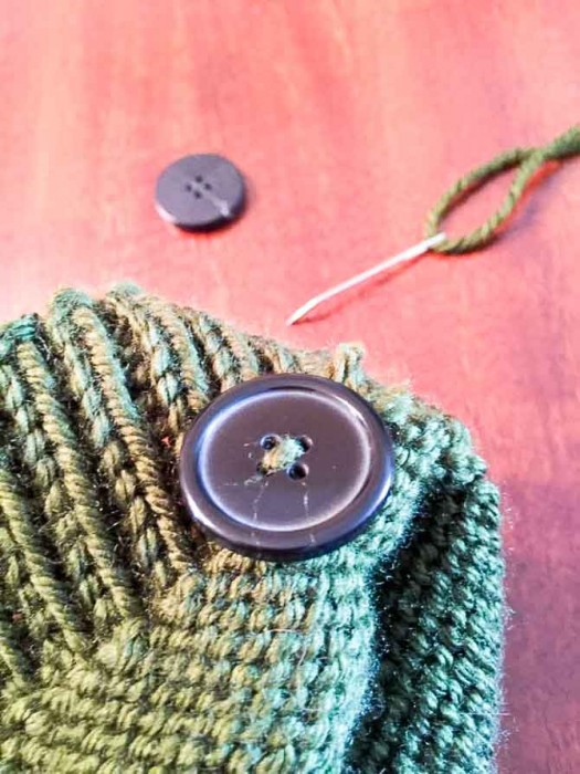 Use large buttons and sew them on opposite sides of the inside of the hat.