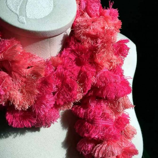 The Positive Pink Ruffles scarf pattern made with the Red Heart Boutique Sashay Fringe yarn.