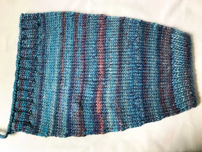 The unseamed arm warmer, after being blocked flat.