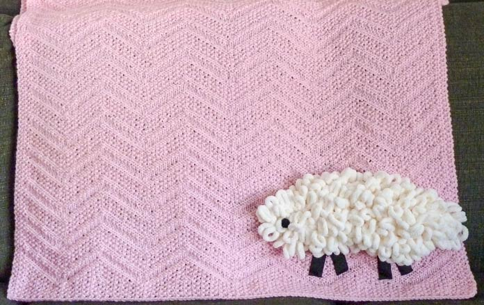 The final result of my giggle knitting - a sheep on a blanket!