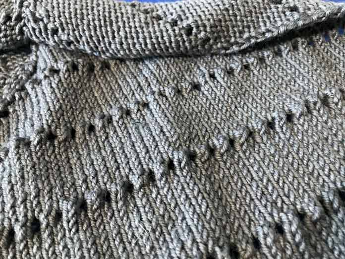 This is what the eyelets looked like before blocking. You might want to scroll back to this photo after you see the end result.