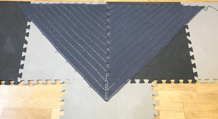 My shawl blocking on my craft room floor.