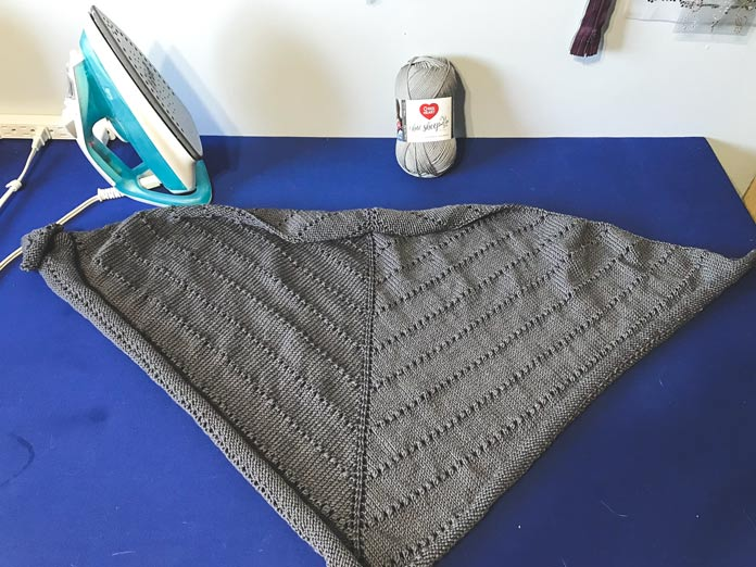 Here's my 'before' picture. This shawl was fresh off the needles, cast off and onto the blocking board.