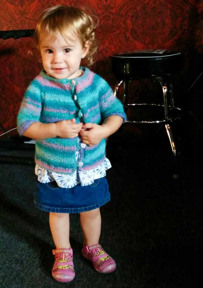1 year-old wearing a top-down hand-knit cardigan in Classic Shades Metallic