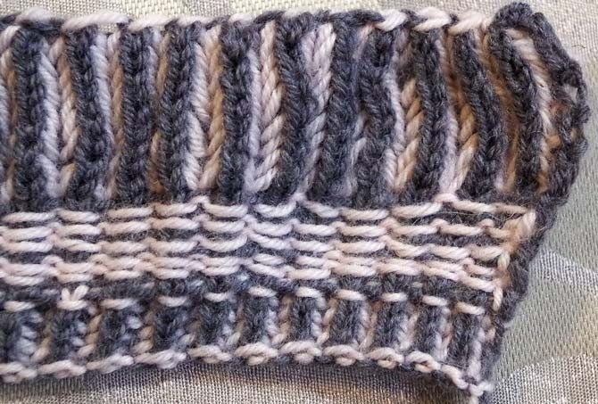 The charcoal gray Bella Cash stands out on the the wrong side of a brioche swatch with the corrugated ribbing showing.