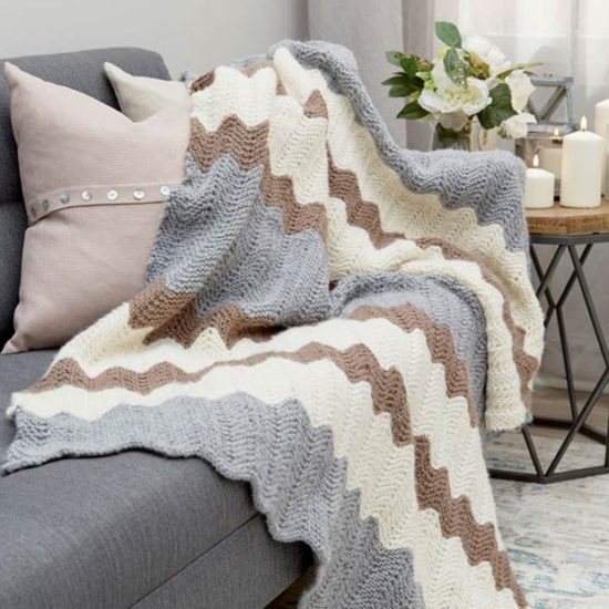 The Calming Colors Chevron Throw product photo from the Red Heart website