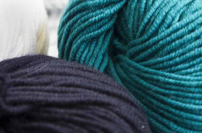 Close up of Dona of Universal Yarns in color: Teal