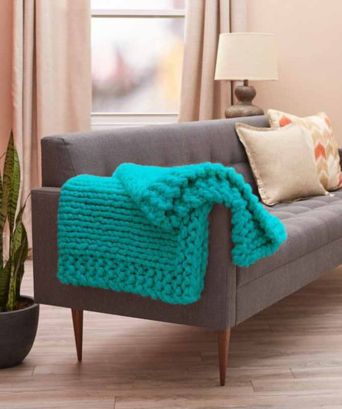 Cool Comfort Knit Throw is much quicker than my blanket. It has less stitches and rows. Although, my blanket is still a quick knit. - Red Heart Boutique Irresistible Yarn