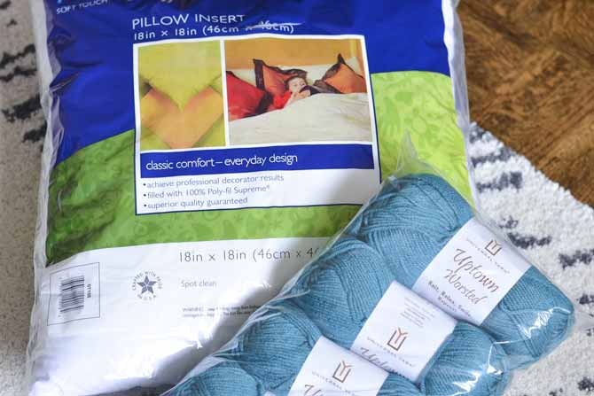 A few skeins of yarn and a foam pillow insert will be transformed into a cozy pillow!