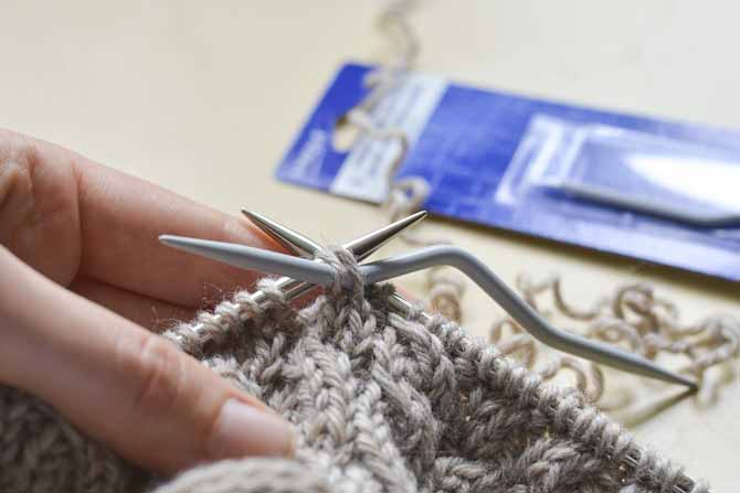 C4L (left cable over 4 sts) Step 3: Slip the first 2 stitches back onto the left hand needle, from the cable needle, then knit them as normal.