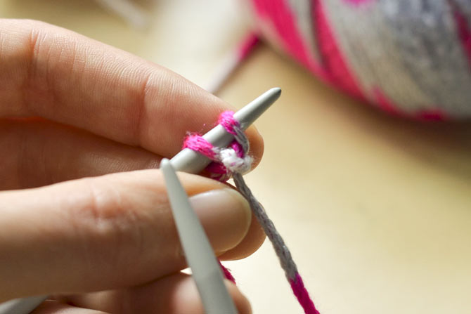 Start with a slip knot, then knit a 2nd stitch using the knitted cast on.