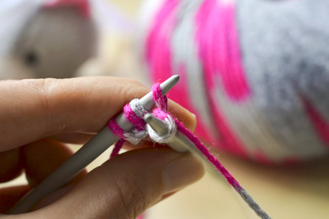 Pull the loop through as you would for making a stitch.