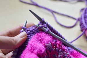 Step 3: Use the crochet hook to grab the loose bar just above the dropped stitch....