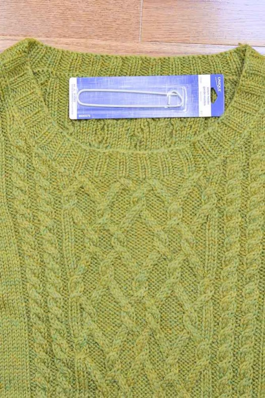 The bottom of a sweater neckline is one of the most common places to use a stitch holder.