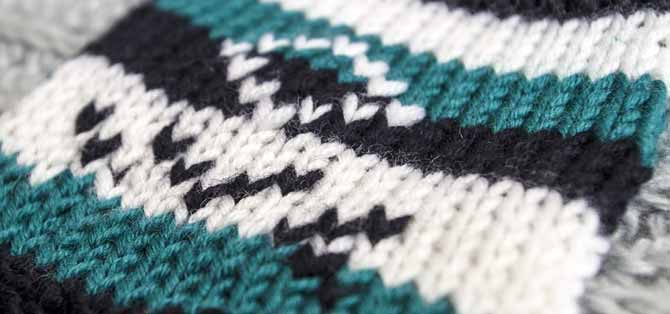 Swiss darning on knit stripes