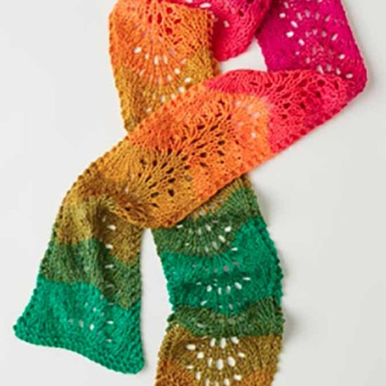 Give the Fantastic Ripple Scarf pattern a try. As an intermediate pattern, you're bound to learn a couple new skills during the knitting process.