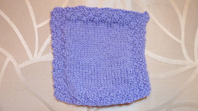 My sample has 34 sts and a double seed stitch border. I achieved the ball band gauge using US 5 [3.75mm] needles
