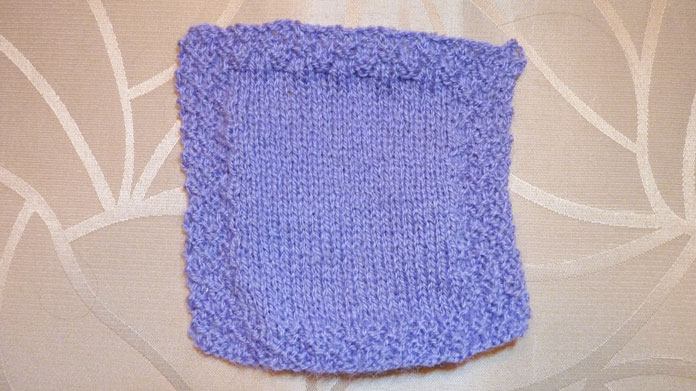 This is my flat-knit swatch. Today I'll make several swatches in the round, the way I will knit my gloves.