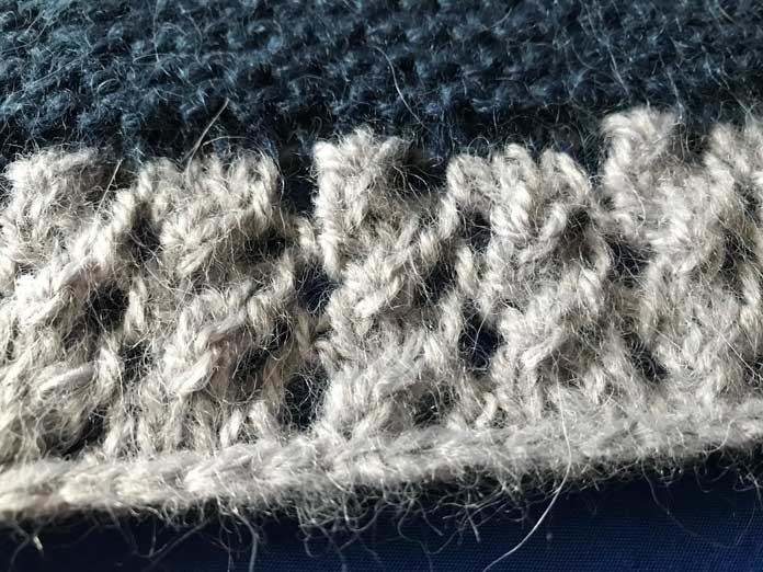 The eyelets along the edge of the Flying V shawl