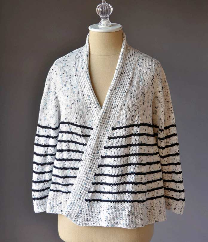 The combination of angled ribbing, stripes, and wrapped V-neck opening, along with the black and blue speckles make this a jaunty, fun piece for anyone's spring or fall wardrobe. A great office cardigan!