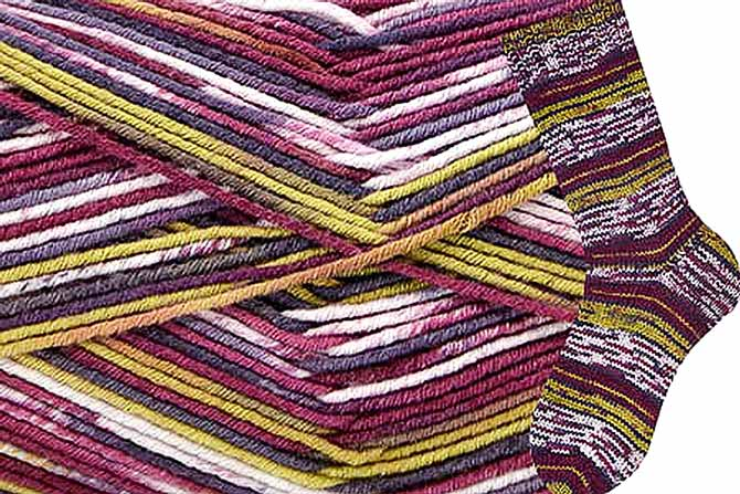 A close up of a skein with a distance shot of finished sock showing purple, blue, green, and white stripes