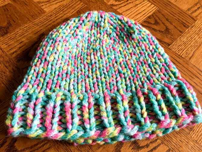 Red Heart Boutique Twilight yarn in a simple hat pattern