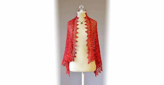 A delicate lace shawl with a triangular lace border made out of red colorway called Cardinal Rule