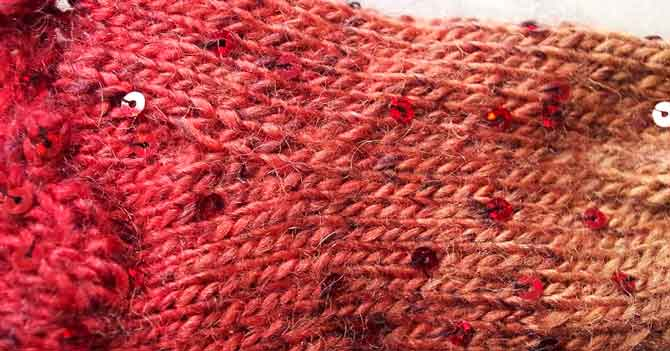 Close-up of a slipper sock showing how the sequins are spaced randomly yet consistently throughout the stockinette fabric