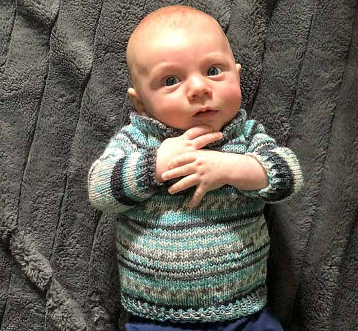 Knitting a top-down baby sweater in Wacki Saki - 1 ball!