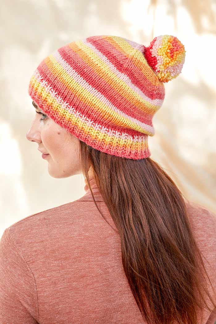 Warm colors to warm your ears in winter. Knitting with Universal Yarn Deluxe Stripes